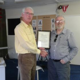 Outgoing Honorary Curator receiving certificate of Life Membership from successor Alastair Crombie