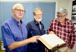 Colin (Central Coast), Ian (Alstonville) and Terry Southwell (Sydney) inspecting the Veness Bible.
