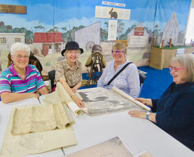 Helen Warman, Marion Warman, Marilyn Folger and Karen Moore, checking over some early maps.