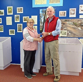 Melissa Lee presenting a cheque to Hon Curator Alastair Crombie