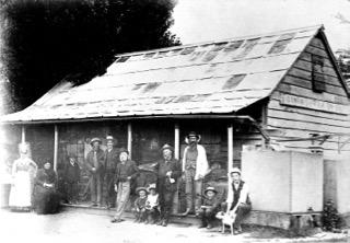 Ginninderra Store and Post Office. http://museum.hall.act.au/display/1939/person/1954/george-harcourt.html[George Harcourt] with the paper under his arm.